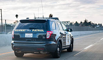 CA Highway Patrol vehicle driving on a highway