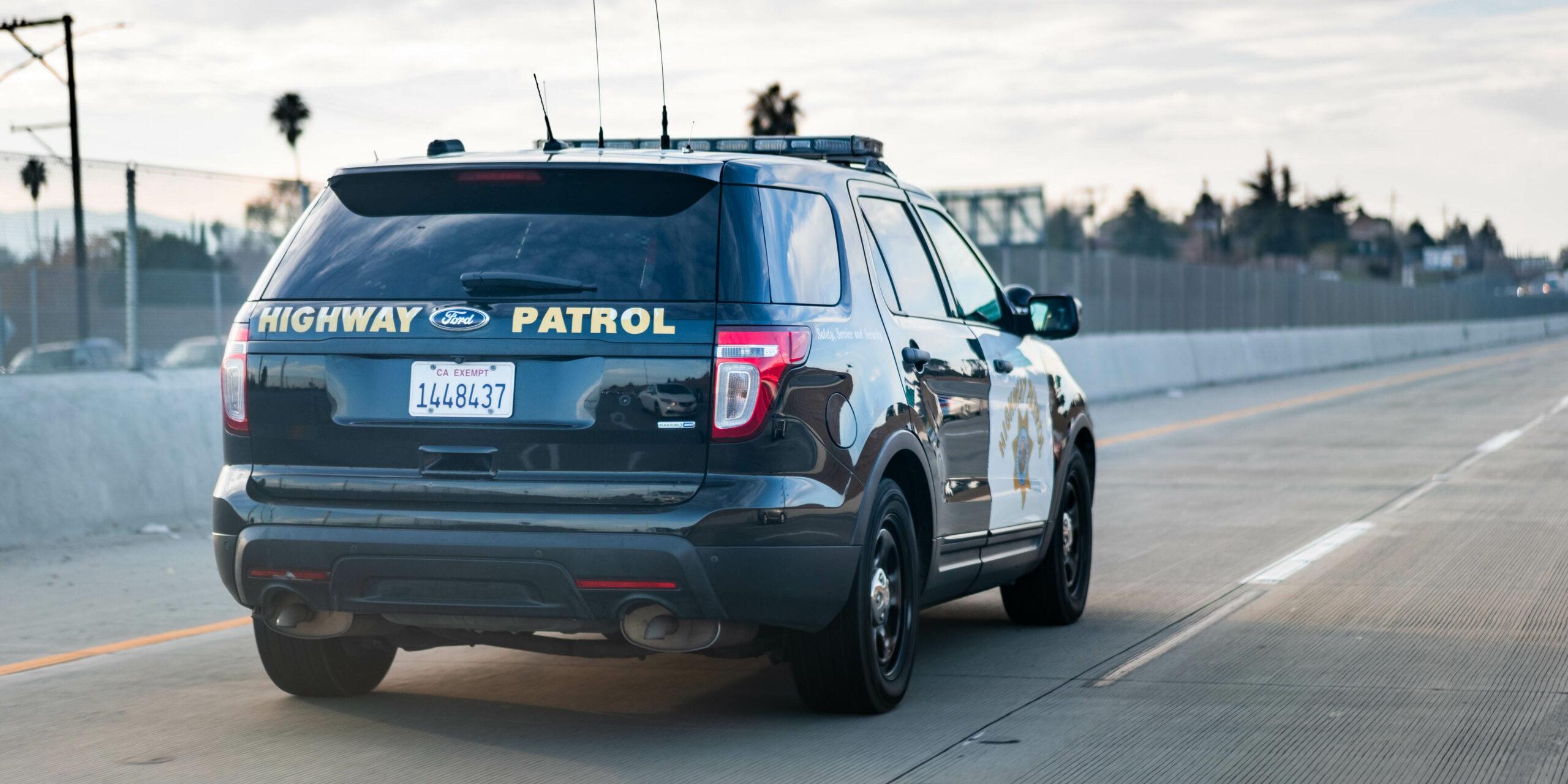 California Highway Patrol vehicle driving on highway