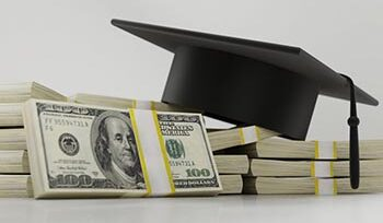 Picture of money and a college graduation cap