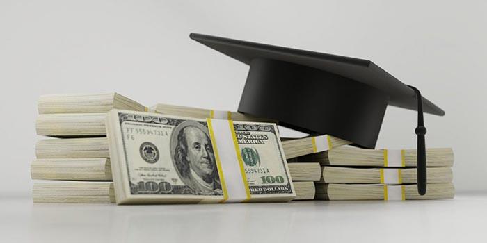 Image of cash and a graduation cap